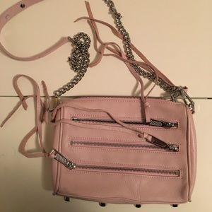Pink Rebecca Minkoff zipper chain cross body bag.
